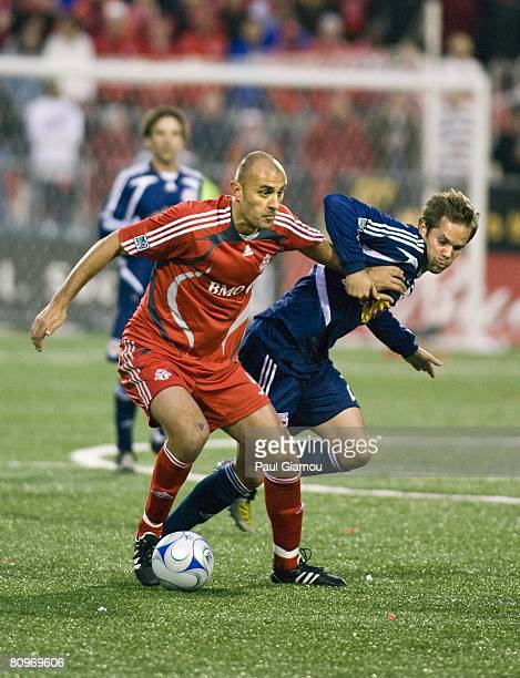 Forward Danny Dichio of the Toronto FC battles for the ball with defender Kevin Goldthwaite of the New York Red Bulls on May 1, 2008 at BMO Field in...