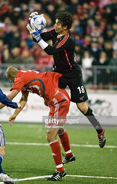 Forward Danny Dichio of the Toronto FC jumps for the ball against goalkeeper Jon Conway of the New York Red Bulls on May 1, 2008 at BMO Field in...