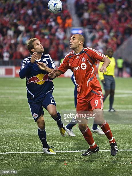 Forward Danny Dichio of the Toronto FC jumps for the ball with defender Kevin Goldthwaite of the New York Red Bulls during their game at BMO Field...