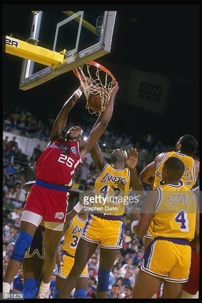 Forward Danny Manning of the Los Angeles Clippers in action against forward James Worthy of the Los Angeles Lakers during a game at the Great Western...