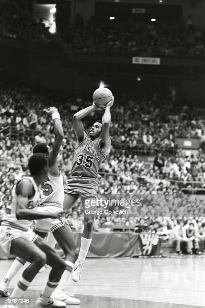 Forward Darrell Griffith of the Louisville Cardinals shoots during a college basketball game against the Ohio State Buckeyes at St John Arena circa...