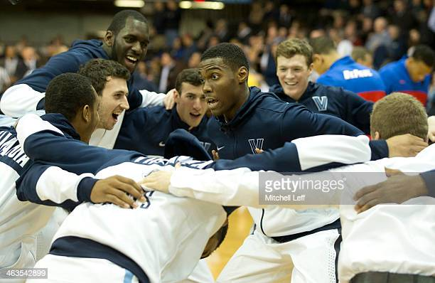 Forward Darryl Reynolds of the Villanova Wildcats dances in the huddle prior to the game against the DePaul Blue Demons on January 18 2014 at the...