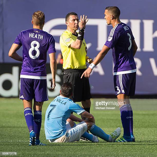Forward David Villa of New York City FC, midfielder Harrison Heath and defender Seb Hines of Orlando City FC during the match at Yankee Stadium on...