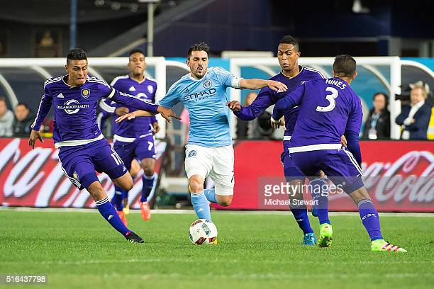 Forward David Villa of New York City FC tried to push the ball past Orlando City SC players Carlos Rivas, Tommy Redding and Seb Hines during the...