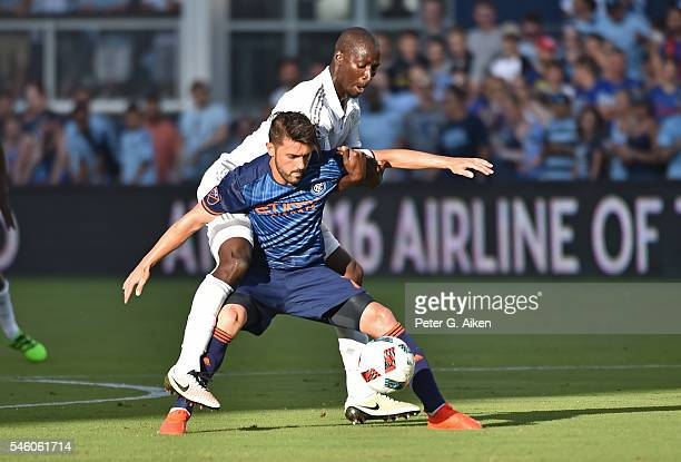 Forward David Villa of the New York City FC battles for the ball against Ike Opara of Sporting Kansas City during the first half on July 10 2016 at...