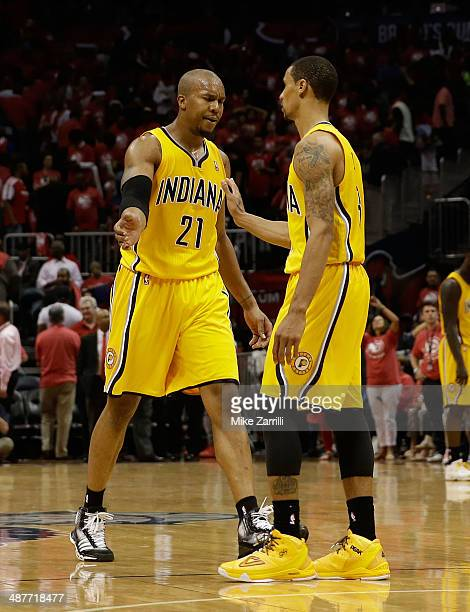 Forward David West of the Indiana Pacers congratulates guard George Hill of the Indiana Pacers at the end of Game 6 of the Eastern Conference...