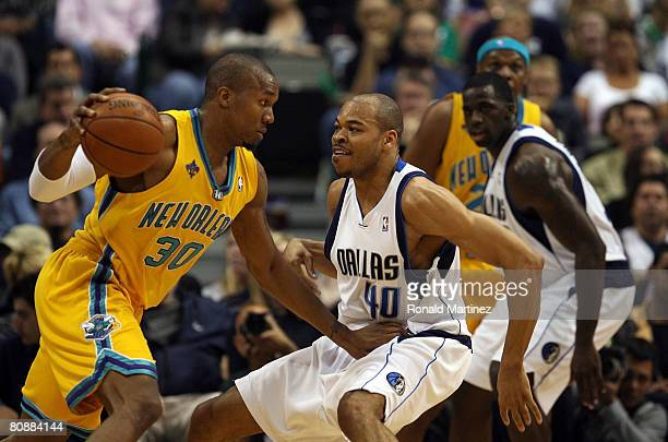 bee091ec021a Forward David West of the New Orleans Hornets moves the ball against Devean  George of the