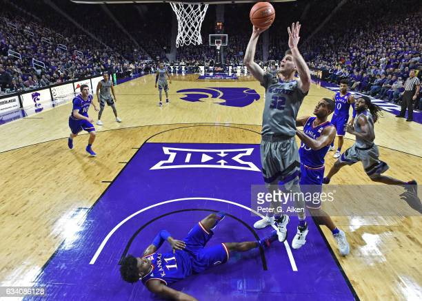 Forward Dean Wade of the Kansas State Wildcats scores over guard Josh Jackson of the Kansas Jayhawks during the first half on February 6, 2017 at...