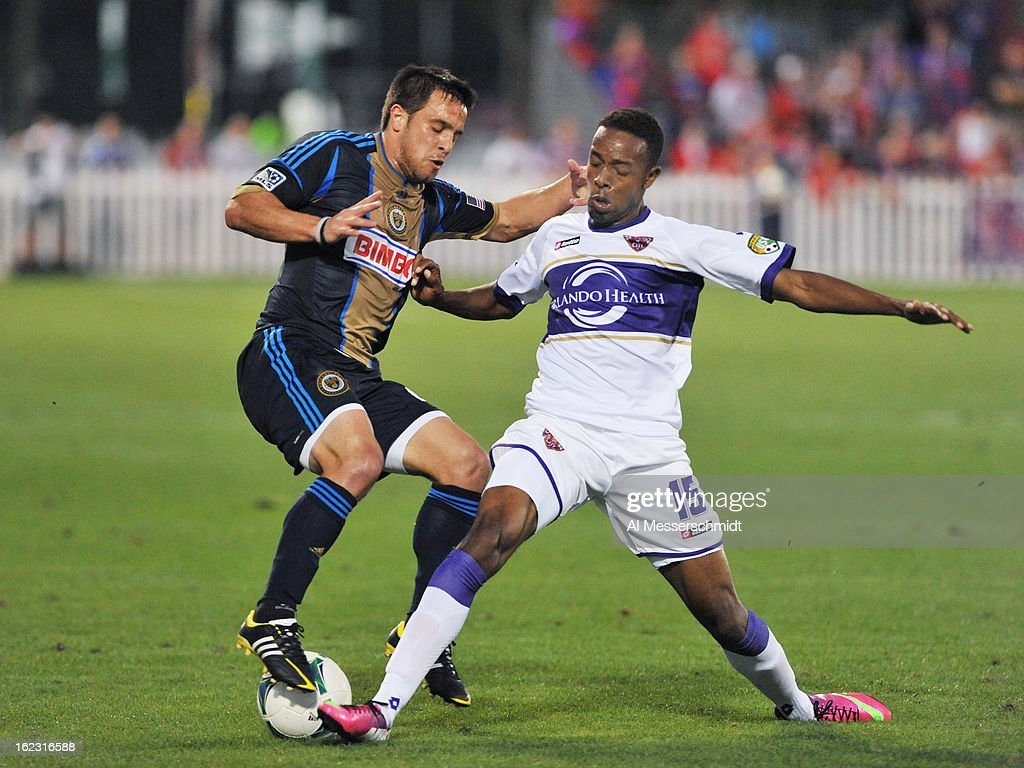 Forward Dennis Chin #15 of Orlando City battles midfielder Danny Cruz #44 of the Philadelphia Union February 9, 2013 in the first round of the Disney Pro Soccer Classic in Orlando, Florida. The match ended in a 1 - 1 tie.