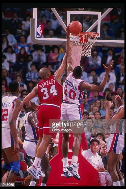 Forward Dennis Rodman of the Detroit Pistons battles for the ball with forward Charles Barkley of the Philadelphia 76ers during a game at The Palace...