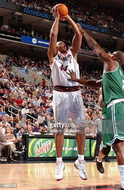 Forward Derrick Coleman of the Philadelphia 76ers shoots a jump shot against forward Antoine Walker of the Boston Celtics during the game at the...
