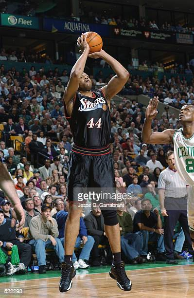 Forward Derrick Coleman of the Philadelphia 76ers shoots over forward Antoine Walker of the Boston Celtics during game 5 of the Eastern Conference...