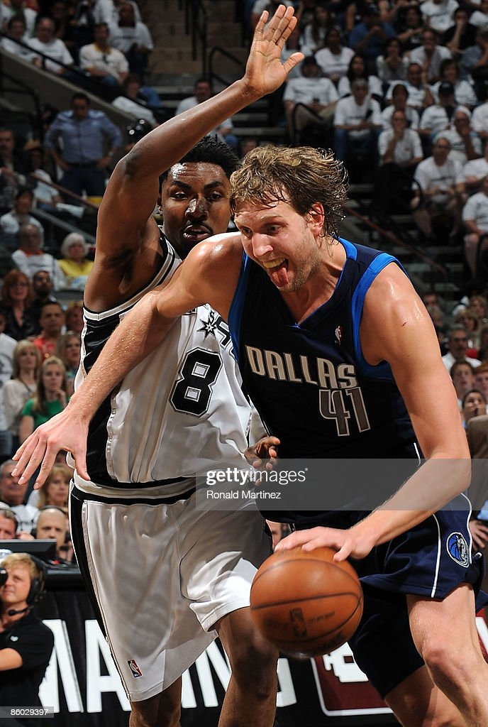 Forward Dirk Nowitzki #41 of the Dallas Mavericks dribbles the ball past Roger Mason Jr. #8 of the San Antonio Spurs in Game One of the Western Conference Quarterfinals during the 2009 NBA Playoffs at AT&T Center on April 18, 2009 in San Antonio, Texas.
