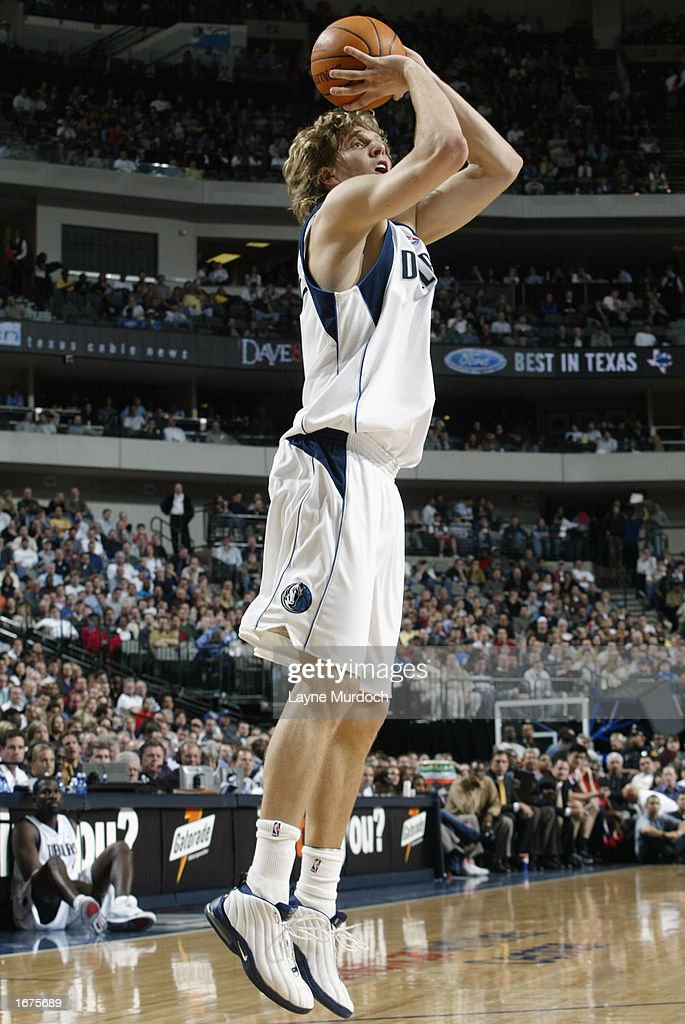 Forward Dirk Nowitzki #41 of the Dallas Mavericks shoots an open jumper against the Houston Rockets during the game at American Airlines Center on November 21, 2002 in Dallas, Texas. The Mavericks won 103-90.