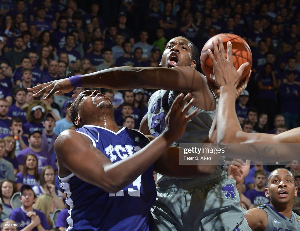 Forward D.J. Johnson (R) of the Kansas State Wildcats fouls forward Devonta Abron #23 of the Texas Christian Horned Frogs during the first half on March 5, 2013 at Bramlage Coliseum in Manhattan, Kansas.