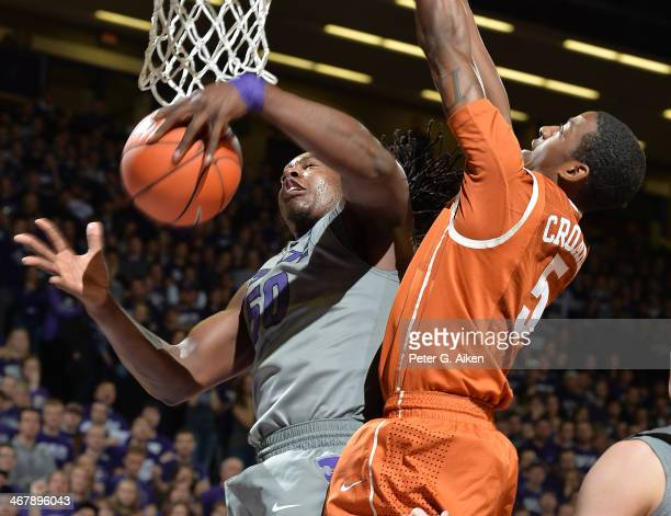 Forward D.J. Johnson of the Kansas State Wildcats grabs a rebound against guard Damarcus Crocker of the Texas Longhorns during the second half on...