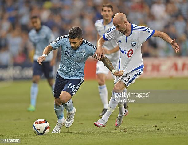 Forward Dom Dwyer of Sporting Kansas City dribbles the ball against defender Laurent Ciman of the Montreal Impact during the second half on July 18...