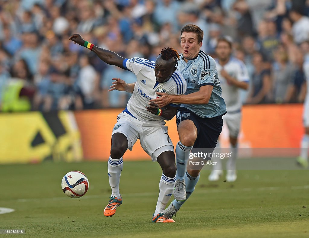 Forward Dominic Oduro #7 of the Montreal Impact battles for the ball against defender Matt Besler #5 of Sporting Kansas City during the first half on July 18, 2015 at Sporting Park in Kansas City, Kansas.