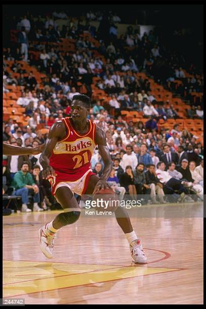 Forward Dominique Wilkins of the Atlanta Hawks dribbles down the court during a game