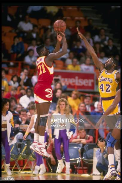 Forward Dominique Wilkins of the Atlanta Hawks shoots the ball during a game against the Los Angeles Lakers at the Great Western Forum in Inglewood...