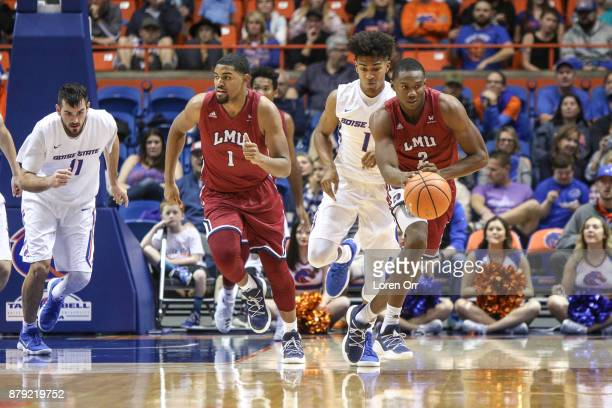 Forward Donald Gipson of the Loyola Marymount Lions drives a fast break opportunity during second half action against the Boise State Broncos on...
