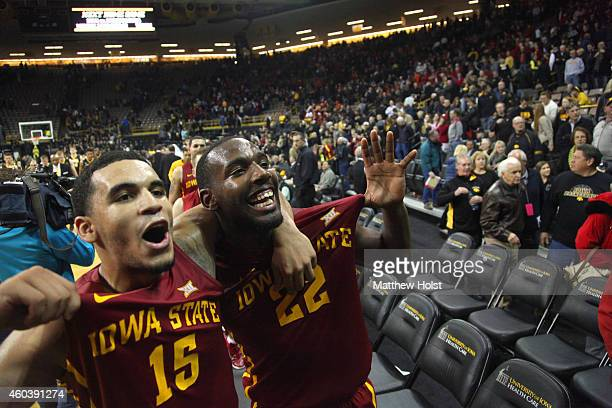 Forward Dustin Hogue and guard Naz Long of the Iowa State Cyclones celebrate after defeating the Iowa Hawkeyes on December 12 2014 at CarverHawkeye...