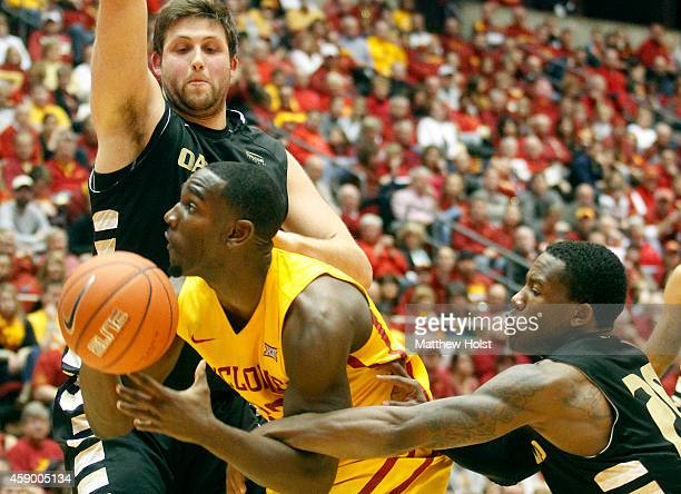 Forward Dustin Hogue of the Iowa State Cyclones drives to the basket between center Corey Petros and guard Kahlil Felder of the Oakland Golden...