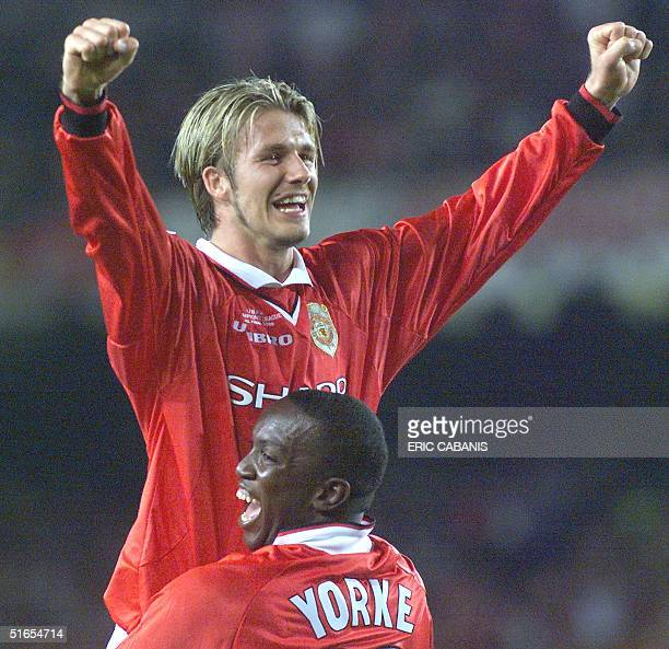 Forward Dwight Yorke and midfielder David Beckham of Manchester United jubilate after winning the final of the soccer Champions League against Bayern...