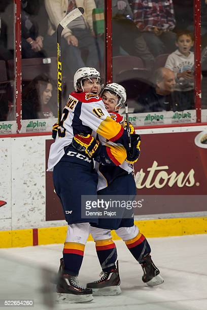 Forward Dylan Strome celebrates with linemate Alex DeBrincat of the Erie Otters after a goal against the Windsor Spitfires on February 6 2016 at the...