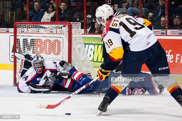 Forward Dylan Strome of the Erie Otters positions himself for a perfect chance at a goal against goaltender Michael DiPietro of the Windsor Spitfires...