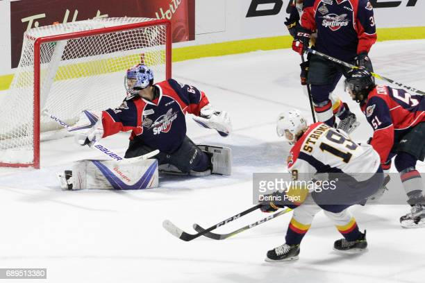 Forward Dylan Strome of the Erie Otters scores a first period goal against goaltender Michael DiPietro of the Windsor Spitfires on May 28 2017 during...