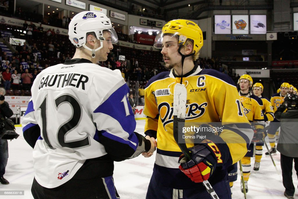 Forward Dylan Strome #19 of the Erie Otters shakes hands with forward Julien Gauthier #12 of the Saint John Sea Dogs after a 6-3 Erie win on May 26, 2017 during the semifinal game of the Mastercard Memorial Cup at the WFCU Centre in Windsor, Ontario, Canada.
