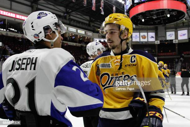 Forward Dylan Strome of the Erie Otters shakes hands with forward Mathieu Joseph of the Saint John Sea Dogs after a 63 Erie win on May 26 2017 during...