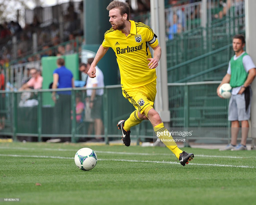 Forward Eddie Gaven #12 of the Columbus Crew runs upfield against the Philadelphia Union February 13, 2013 in the second round of the Disney Pro Soccer Classic in Orlando, Florida.