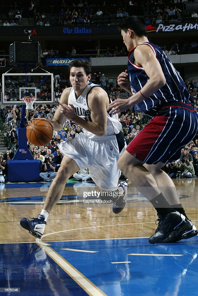 Forward Eduardo Najera #14 of the Dallas Mavericks drives against center Yao Ming #11 of the Houston Rockets during the game at American Airlines Center on November 21, 2002 in Dallas, Texas. The Mavericks won 103-90.