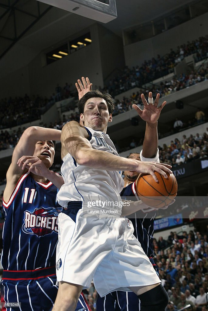 Forward Eduardo Najera #14 of the Dallas Mavericks rebounds against center Yao Ming #11 of the Houston Rockets during the game at American Airlines Center on November 21, 2002 in Dallas, Texas. The Mavericks won 103-90.