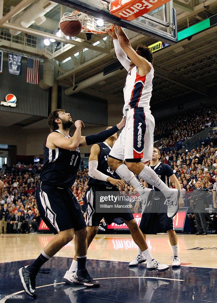 Forward Elias Harris #20 of the Gonzaga Bulldogs dunks while John Sinis #31 and Jito Kok #33 of the San Diego Toreros defend during the first half of the game at McCarthey Athletic Center on February 23, 2013 in Spokane, Washington.