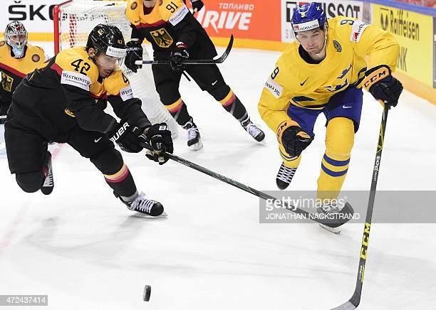 Forward Filip Forsberg of Sweden and forward Yasin Ehliz of Germany vie for the puck during the group A preliminary round match Sweden vs Germany at...