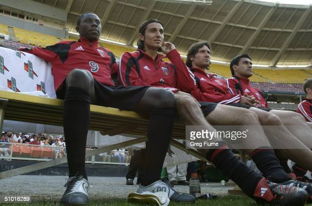 Forward Freddy Adu of DC United and his teammate midfielder Kevin Ara watch the game against the Chicago Fire at RFK Stadium on April 24 2004 in...