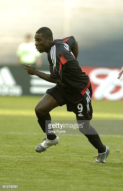 Forward Freddy Adu of D.C. United runs during the game against the Chicago Fire at RFK Stadium on April 24, 2004 in Washington, DC. The Fire won the...