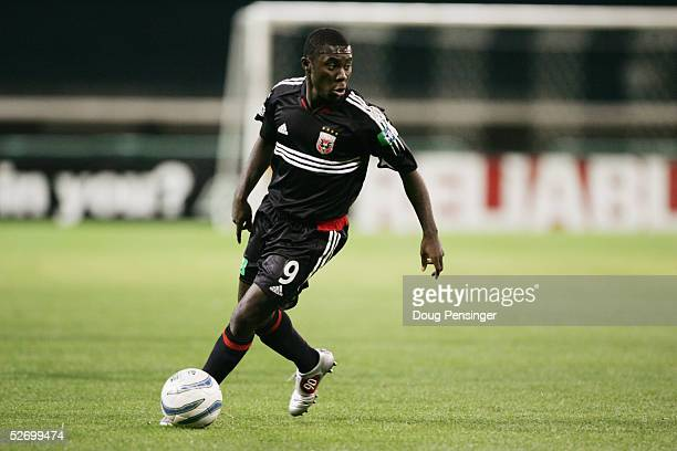 Forward Freddy Adu of the DC United dribbles the ball against the Chicago Fire during MLS game at Robert F Kennedy Stadium on April 9 2005 in...