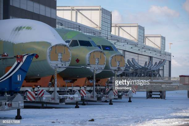 Forward fuselage cockpit sections for Airbus A320 narrowbody twinengine passenger jets stand outside the Airbus SE factory ahead of shipping in...