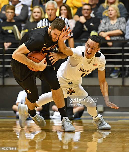Forward Gabe Levin of the Long Beach State 49ers is fouled by guard Landry Shamet of the Wichita State Shockers during the first half on November 13...