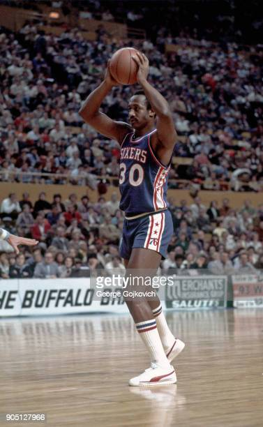 Forward George McGinnis of the Philadelphia 76ers looks to pass the basketball during a National Basketball Association game against the Buffalo...