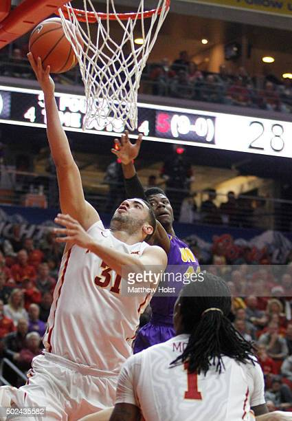 Forward Georges Niang of the Iowa State Cyclones drives to the basket in the first half against guard Wes Washpun of the Northern Iowa Panthers on...