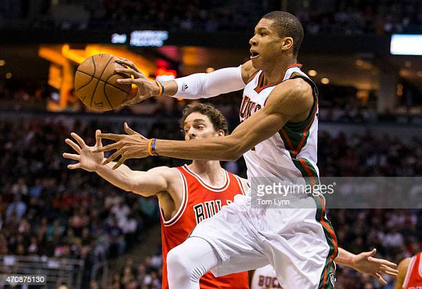 Forward Giannis Antetokounmpo of the Milwaukee Bucks passes against center Pau Gasol of the Chicago Bulls in the first quarter during during game...