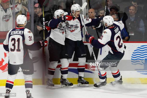 Forward Graham Knott of the Windsor Spitfires celebrates his firstperiod goal against goaltender Carl Stankowski of the Seattle Thunderbirds on May...