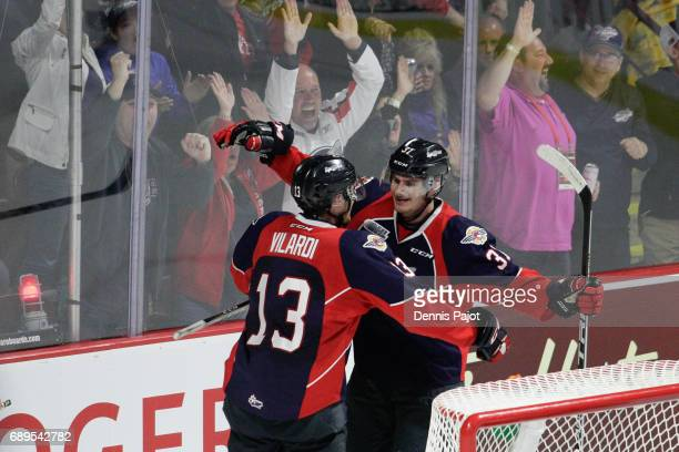 Forward Graham Knott of the Windsor Spitfires celebrates his second period goal with teammate Gabriel Vilardi on May 28 2017 during the championship...
