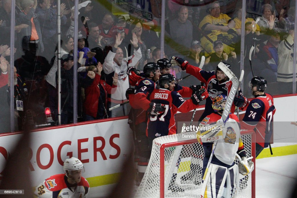 Forward Graham Knott #37 of the Windsor Spitfires celebrates his second period goal with teammate Gabriel Vilardi #13 on May 28, 2017 during the championship game of the Mastercard Memorial Cup at the WFCU Centre in Windsor, Ontario, Canada.