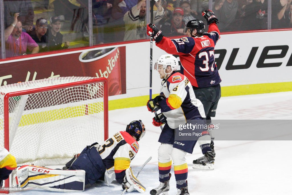Forward Graham Knott #37 of the Windsor Spitfires celebrates his second period goal against goaltender Troy Timpano #33 of the Erie Otters on May 28, 2017 during the championship game of the Mastercard Memorial Cup at the WFCU Centre in Windsor, Ontario, Canada.